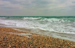 Sea in bad weather. On beach in bad weather Stock Image
