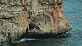 The sea is baked over the surface of the water in the rocks. Spanish beaches in Cala Mendia. Mallorca