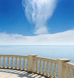 Sea from a balcony under clouds Stock Photo