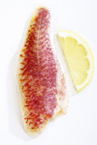 Sea barbel filet with lemon slice royalty free stock photography