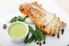 Sea-bass. Chilean sea bass in papilliote with sauce royalty free stock photo