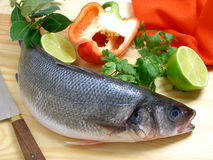 Sea bass with bell pepper. Sea bass on the cutting board with bell pepper stock photography