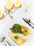 Sea Bass and candles Stock Images