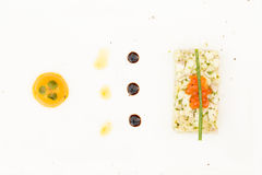 Sea bass ceviche with ginger, salmon caviar, mango puree and pes Royalty Free Stock Photo