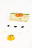 Sea bass ceviche with ginger, salmon caviar, mango puree and pes Royalty Free Stock Images