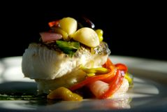 Sea bass dinner. Image of grilled sea bass with vegetables Royalty Free Stock Photo