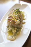 Sea Bass Dish. Photograph of a sea bass dish on a white plate stock photography