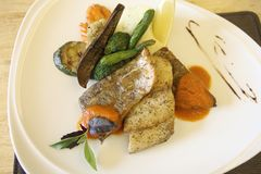 Sea bass fillet. On a plate stock photography