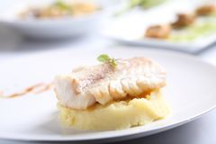 Sea bass fillet. On a plate stock images