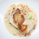 Sea bass fillet. On a plate royalty free stock photography