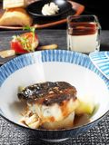 Sea bass fillet. With asparagus and sauce in the bowl stock images