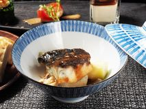 Sea bass fillet. With asparagus and sauce in the bowl royalty free stock image