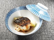 Sea bass fillet. With asparagus and sauce in the bowl stock photography