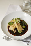 Sea bass fillet with black vinegar Royalty Free Stock Image