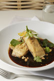 Sea bass fillet with black vinegar Stock Photos