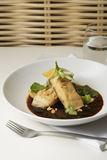 Sea bass fillet with black vinegar Stock Images