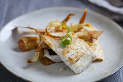 Sea bass fillet with parsnip crisps Stock Image