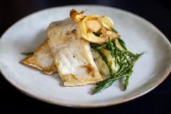 Sea bass fillet with parsnip crisps Stock Photos