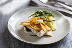 Sea bass fillet with parsnip crisps Stock Photography