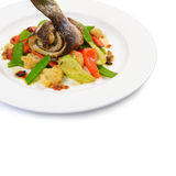 Sea bass fillet with spring vegetables Royalty Free Stock Photography