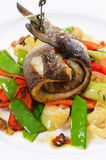 Sea bass fillet with spring vegetables. And sauce Royalty Free Stock Images