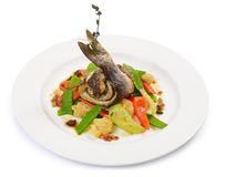 Sea bass fillet with spring vegetables Stock Photography