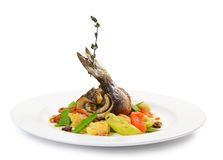 Sea bass fillet with spring vegetables Royalty Free Stock Images