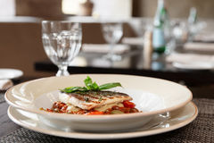 Sea bass fillet with tomato sauce and capers Stock Photography