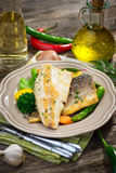 Sea bass fillet with vegetables Royalty Free Stock Photography
