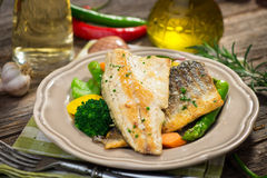 Sea bass fillet with vegetables Royalty Free Stock Images