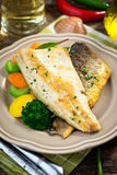 Sea bass fillet with vegetables Royalty Free Stock Photos