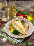 Sea bass fillet with vegetables Stock Photos