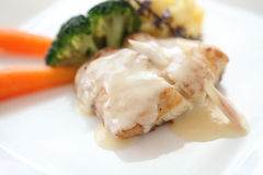 Sea bass fillet with white sauce Royalty Free Stock Photo