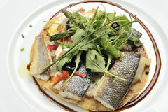 Sea bass fillets. With salad canons stock images