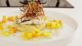 Sea bass fish with potato and carrots stock footage