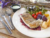 Sea bass Fish steak. On the wooden table Stock Photos