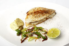 Sea bass on grate with lime Stock Photo
