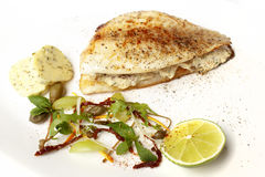 Sea bass on grate with lime Stock Images