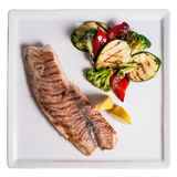 Sea bass grilled. Sea bass and grilled vegetables Royalty Free Stock Images