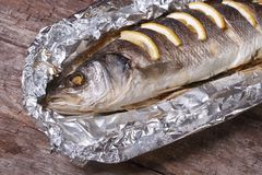 Sea bass with lemon baked in foil. closeup Stock Photography