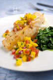 Sea bass with mango salsa Stock Image