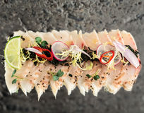 Sea bass new style sashimi. Over concrete background royalty free stock image