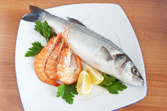 Sea bass with parsley and prawns Stock Photo