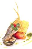 Sea bass roasted with garnish Stock Images
