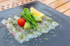 Sea bass sashimi. Mediterranean style cuisine royalty free stock photos