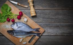 Sea bass and sea bream with vegetables. royalty free stock images