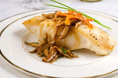 Sea bass with shiitake. Pan seared Chilean sea bass with shiitake mushrooms stock photo