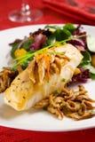 Sea bass with shiitake mushrooms royalty free stock photos