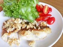 Sea bass steak. With crispy fried garlic stock photo