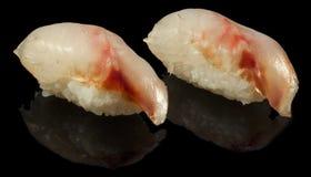 Sea bass sushi nigiri. On a black background Stock Images